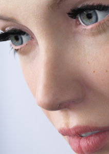 Close up of woman's face with blue eyes