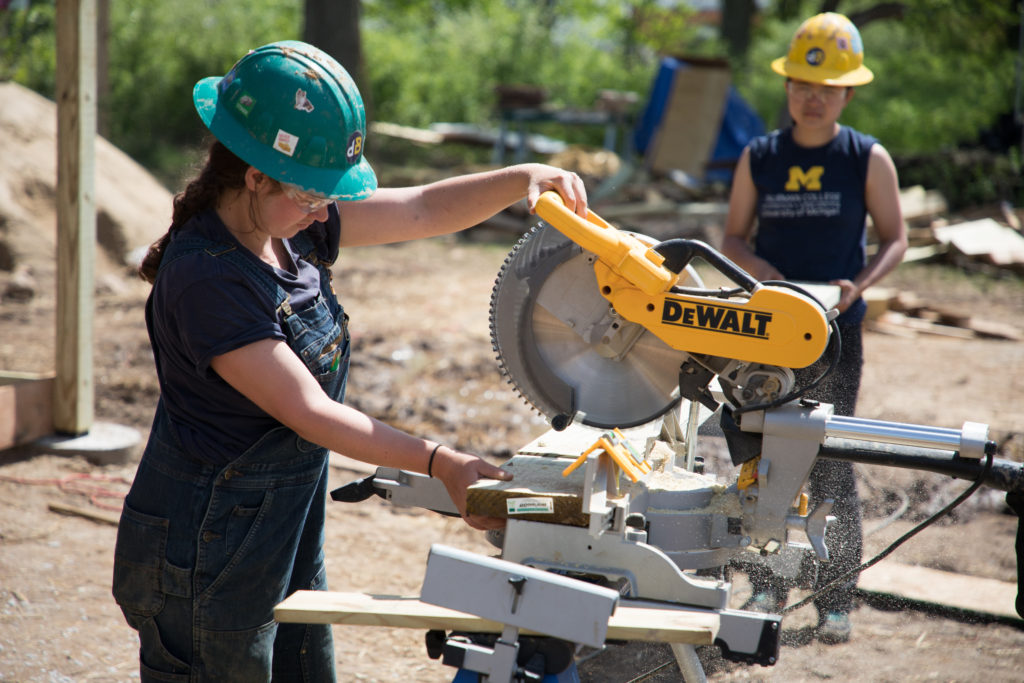 Female student operates a table circle saw