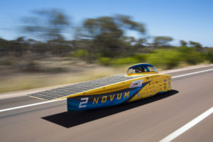 The University of Michigan Solar Car Novum speeds down the Stuart Highway in Australia in the 2017 World Solar Challenge. The team will soon race Novum in the American Solar Challenge on the Oregon Trail. Photo by Evan Dougherty