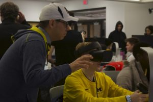 Students operate Oculus Rift headsets to operate virtual cameras and reshoot the scene