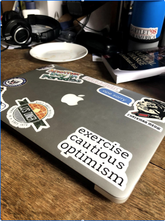 Picture of a laptop with stickers on it